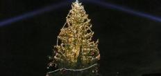 Kinderburgemeester versiert kerstboom voor Gouda bij Kaarslicht