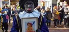 Het geheim van Sinterklaas, hoe heet de beer van Knuffelpiet?